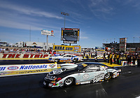 Apr. 5, 2013; Las Vegas, NV, USA: (Editors note: Special effects lens used in creation of this image) NHRA pro stock driver Vincent Nobile (near lane) races alongside Allen Johnson during qualifying for the Summitracing.com Nationals at the Strip at Las Vegas Motor Speedway. Mandatory Credit: Mark J. Rebilas-