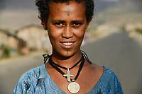 ETHIOPIA, Amhara, village near Gondar, amharic orthodox christian woman with tattooed cross on the forehead and cross necklace / AETHIOPIEN, Amhara, Gonder, orthodoxe Christin mit auf der Stirn taetowiertem Kreuz und Halskette in einem Dorf