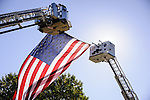 Ladder trucks and a United States flag are displayed at the 2012 annual induction ceremony at the Nevada Firefighters' Memorial in Carson City, Nevada.