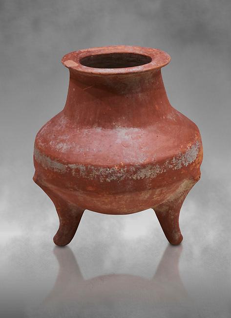 Hittite terra cotta pot on trident legs. Hittite Old Period, 1650 - 1450 BC.  Hattusa Boğazkale. Çorum Archaeological Museum, Corum, Turkey. Against a grey bacground.