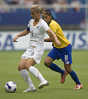 New Zealand defender (6) Rebecca Smith and Brazil forward (11) Cristiane.  Brazil (BRA) defeated New Zealand (NZL) 5-0 in their  FIFA Women's World Cup China 2007 Group D opening round match at Wuhan Sports Center Stadium in Wuhan, China on September 12, 2007.