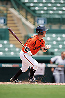 GCL Orioles left fielder Max Hogan (15) follows through on a swing during a game against the GCL Rays on July 21, 2017 at Ed Smith Stadium in Sarasota, Florida.  GCL Orioles defeated the GCL Rays 9-0.  (Mike Janes/Four Seam Images)