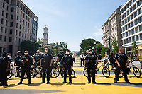 Police block Black Lives Matter Plaza near the White House in Washington D.C., U.S., as crews clean the area on Tuesday, June 23, 2020.  Trump tweeted that he authorized the Federal government to arrest any demonstrator caught vandalizing U.S. monuments, with a punishment of up to 10 years in prison.  Credit: Stefani Reynolds / CNP/AdMedia