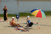- bathing people in beach with beach umbrella..- bagnanti in spiaggia con ombrellone..