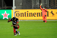 WASHINGTON, DC - OCTOBER 28: Donovan Pines #23 of D.C. United kneeling during a game between Columbus Crew and D.C. United at Audi Field on October 28, 2020 in Washington, DC.