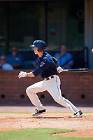 Mobile BayBears designated hitter Hutton Moyer (11) follows through on a swing during a game against the Pensacola Blue Wahoos on April 26, 2017 at Hank Aaron Stadium in Mobile, Alabama.  Pensacola defeated Mobile 5-3.  (Mike Janes/Four Seam Images)