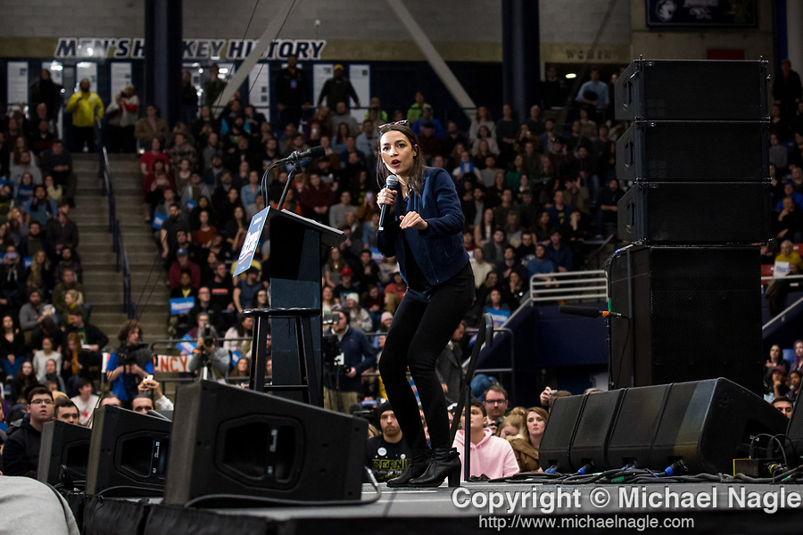 Congresswoman Alexandria Ocasio-Cortez speaks to supporters of U.S. Senator and Democratic Presidential Candidate Bernie Sanders during a rally ahead of the New Hampshire primary election at the University of New Hampshire on Monday, February 10, 2020 in Durham, New Hampshire. Photograph by Michael Nagle/Redux Pictures