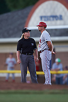 Auburn Doubledays manager Jerad Head (11) argues a call with field umpire Jennifer Pawol during a game against the Batavia Muckdogs on July 4, 2017 at Dwyer Stadium in Batavia, New York.  Batavia defeated Auburn 3-2.  (Mike Janes/Four Seam Images)