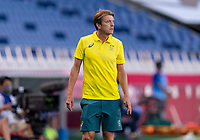 TOKYO, JAPAN - JULY 24: Tony Gustavsson of Australia watches his team during a game between Australia and Sweden at Saitama Stadium on July 24, 2021 in Tokyo, Japan.