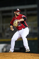 Hickory Crawdads relief pitcher John Fasola (23) in action against the Savannah Sand Gnats at L.P. Frans Stadium on June 15, 2015 in Hickory, North Carolina.  The Crawdads defeated the Sand Gnats 4-1.  (Brian Westerholt/Four Seam Images)
