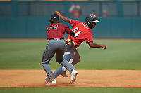 Devin Obee (54) of Ensworth HS in Nashville, TN playing for the Cincinnati Reds scout team is tagged out by pitcher Noah Mrotek (22) of Archbishop Spalding HS in Bowie, MD playing for the Arizona Diamondbacks scout team during the East Coast Pro Showcase at the Hoover Met Complex on August 4, 2020 in Hoover, AL. (Brian Westerholt/Four Seam Images)