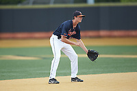 Virginia Cavaliers shortstop Tanner Morris (10) on defense against the Wake Forest Demon Deacons at David F. Couch Ballpark on May 19, 2018 in  Winston-Salem, North Carolina. The Demon Deacons defeated the Cavaliers 18-12. (Brian Westerholt/Four Seam Images)