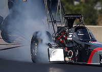 Mar. 17, 2013; Gainesville, FL, USA; NHRA top fuel dragster driver Larry Dixon has some engine damage during the Gatornationals at Auto-Plus Raceway at Gainesville. Mandatory Credit: Mark J. Rebilas-