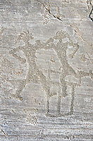 Petroglyph, rock carving, of two warriors boxing. Carved by the ancient Camunni people in the iron age between 1000-1200 BC. Rock no 6, Foppi di Nadro, Riserva Naturale Incisioni Rupestri di Ceto, Cimbergo e Paspardo, Capo di Ponti, Valcamonica (Val Camonica), Lombardy plain, Italy