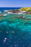 Tourists snorkel in the clear waters of Kealakekua Bay, Big Island.