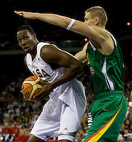 US forward (11) Dwight Howard drives into Lithuania center (15) Robertas Javtokas while playing at the Cotai Arena inside the Venetian Macau Resort and Hotel.  The US defeated Lithuania, 120-84.