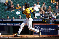 Brandt Belk (21) of the Missouri Tigers follows through on his swing against the Oklahoma Sooners in game four of the 2020 Shriners Hospitals for Children College Classic at Minute Maid Park on February 29, 2020 in Houston, Texas. The Tigers defeated the Sooners 8-7. (Brian Westerholt/Four Seam Images)