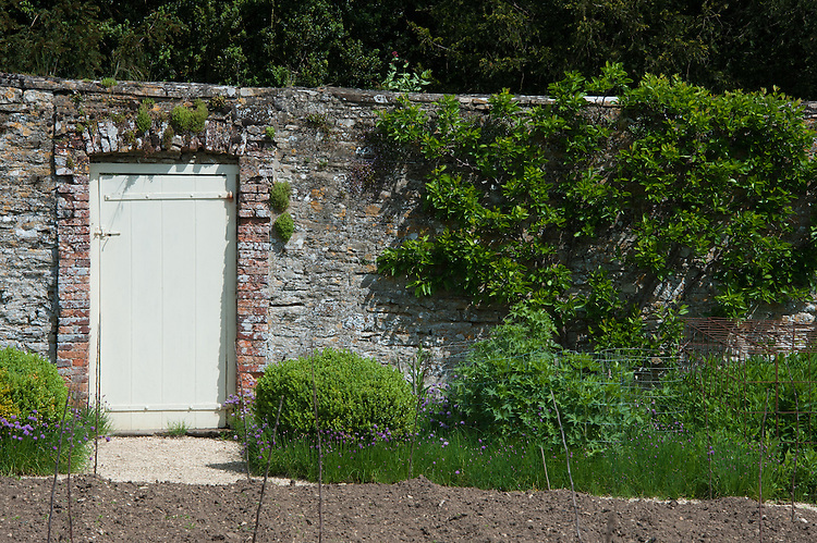Door in the wall of the kitchen garden at Rousham Hall and Garden.