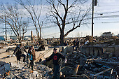 Queens, New York<br /> November 6, 2012<br /> <br /> Residents assess the damaged homes in the Breezy Point section of the Queens borough New York after a fire was set off in the wake of Hurricane Sandy. The tiny beachfront neighborhood burnt down as it was inundated by flood-waters and spread by heavy winds.