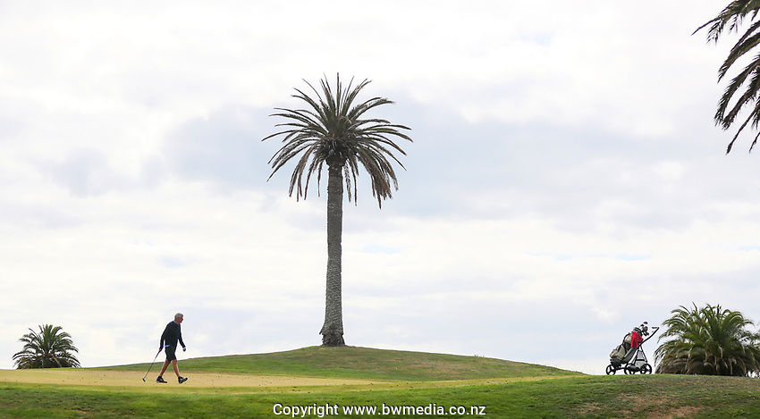 "A player isolates during a solo round at Formosa. Golf during Level 3 Covid 19 isolation regulations. Players playing as part of their ""bubble"" or solo. Whitford park and Formosa Golf Courses. Thursday 30 April 2020. Photo: Simon Watts/www.bwmedia.co.nz"