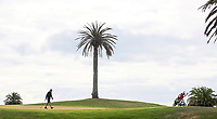 """A player isolates during a solo round at Formosa. Golf during Level 3 Covid 19 isolation regulations. Players playing as part of their """"bubble"""" or solo. Whitford park and Formosa Golf Courses. Thursday 30 April 2020. Photo: Simon Watts/www.bwmedia.co.nz"""