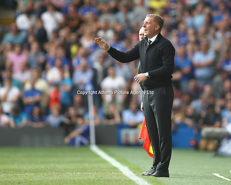 Garry Monk manager of Swansea   during the Barclays Premier League match between  Chelsea and Swansea  played at Stamford Bridge, London