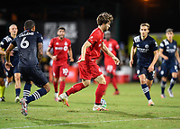 LAKE BUENA VISTA, FL - JULY 26: Patrick Mullins of Toronto FC dribbles the ball during a game between New York City FC and Toronto FC at ESPN Wide World of Sports on July 26, 2020 in Lake Buena Vista, Florida.