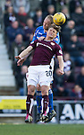 Hearts v St Johnstone…19.03.16  Tynecastle, Edinburgh<br />Steven Anderson gets above Gavin Reilly<br />Picture by Graeme Hart.<br />Copyright Perthshire Picture Agency<br />Tel: 01738 623350  Mobile: 07990 594431