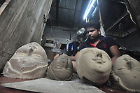 A handicraftsman adds face design to a clay idol of Hindu Goddess Durga before the upcoming Hindu festival Durga Puja in Agartala, capital of Indian northeastern state of Tripura, July 28, 2017. <br /> <br /> Durga Puja is one of the largest Hindu festivals that involves worship of Goddess Durga who symbolizes power and the triumph of good over evil in Hindu mythology.<br /> <br /> PHOTO : agence Quebec Presse<br />  -Abhisek Saha
