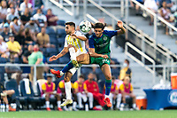 HARTFORD, CT - AUGUST 17: Stavros Zarokostas #9 of Charleston Battery and Justin Haak #80 of Hartford Athletic battle for head ball during a game between Charleston Battery and Hartford Athletic at Dillon Stadium on August 17, 2021 in Hartford, Connecticut.