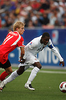 Austria midfielder (11) Peter Hackmair and USA midfielder (11) Freddy Adu battle for the ball. Austria (AUT) defeated the United States (USA) 2-1 in overtime of a FIFA U-20 World Cup quarter-final match at the National Soccer Stadium at Exhibition Place, Toronto, Ontario, Canada, on July 14, 2007.