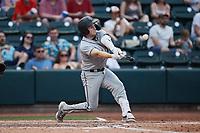 Grant Koch (23) of the Greensboro Grasshoppers at bat against the Winston-Salem Dash at Truist Stadium on June 19, 2021 in Winston-Salem, North Carolina. (Brian Westerholt/Four Seam Images)