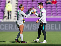 ORLANDO, FL - FEBRUARY 21: Barbara #1 of Brazil fist bumps her coach during a game between Brazil and USWNT at Exploria Stadium on February 21, 2021 in Orlando, Florida.