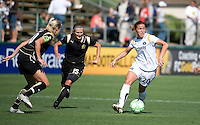 Leslie Osborne and Tiffeny Milbrett try to chase down Camille Abily. The Los Angeles Sol defeated FC Gold Pride, 2-0, at Buck Shaw Stadium in Santa Clara, CA on May 24, 2009.