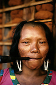 A-Ukre village, Xingu, Brazil. Irepa, a Kayapo woman, smoking a chillom pipe.