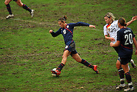 USA's Carli Lloyd charges upfield against Germany.  The USA captured the 2010 Algarve Cup title by defeating Germany 3-2, at Estadio Algarve on March 3, 2010.