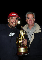 Nov. 11, 2012; Pomona, CA, USA: NHRA funny car driver Cruz Pedregon (left) celebrates with NHRA president Tom Compton after winning the Auto Club Finals at at Auto Club Raceway at Pomona. Mandatory Credit: Mark J. Rebilas-