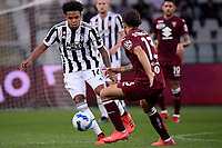 Weston McKennie of Juventus FC and Ricardo Rodriguez of Torino Calcio compete for the ball during the Serie A 2021/2022 football match between Torino FC and Juventus FC at Stadio Olimpico Grande Torino in Turin (Italy), October 2nd, 2021. Photo Federico Tardito / Insidefoto