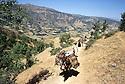 Iran 1981.Near Piranshar, people on a track with donkeys