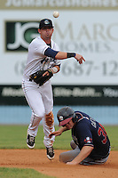 Asheville Tourists second baseman Brett Tanos #9 makes a throw to complete a double play over a hard sliding Evan Gattis during a game against the Rome Braves at McCormick Field on August 21, 2011 in Asheville, North Carolina. Asheville won the game 13-5.   (Tony Farlow/Four Seam Images)