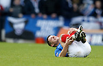 Ian Black in agony after a David Anderson challenge