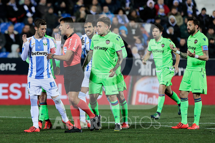 CD Leganes's Ruben Perez and Levante UD's Roger Marti have words with the referee during La Liga match between CD Leganes and Levante UD at Butarque Stadium in Leganes, Spain. March 04, 2019. (ALTERPHOTOS/A. Perez Meca)