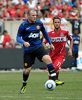 Manchester United forward Wayne Rooney (10) receives the ball as Chicago Fire midfielder Daniel Paladini (11) looks on.  Manchester United defeated the Chicago Fire 3-1 at Soldier Field in Chicago, IL on July 23, 2011.