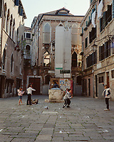 Local children play with a skipping rope in a corner of the Campo Santa Maria dei Miracoli.