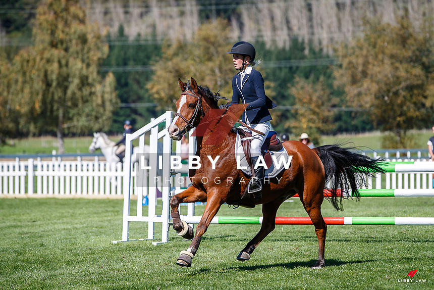 NZL-Aliya Berry rides Pendarras Maxamillion. Class 26: Pony 1.05m Ranking Class. 2021 NZL-Easter Jumping Festival presented by McIntosh Global Equestrian and Equestrian Entries. NEC Taupo. Saturday 3 April. Copyright Photo: Libby Law Photography