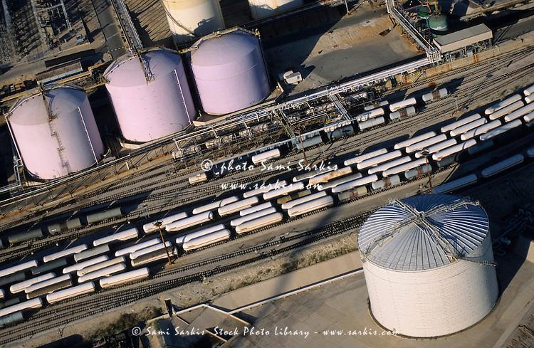 Oil tank and trains on railroad tracks, Lavera, France.