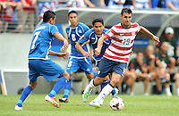 Chris Wondolowski (19) of the USMNT goes against Darwin Ceren Delgado (7) of El Salvador.  The USMNT defeated El Salvador 5-1 at the quaterfinal game of the Concacaf Gold Cup, M&T Stadium, Sunday July 21 , 2013.