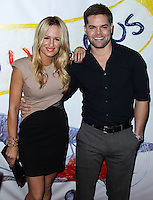 """WEST HOLLYWOOD, CA - NOVEMBER 13: Jenn Brown, Wes Chatham at the """"Stand Up For Gus"""" Benefit held at Bootsy Bellows on November 13, 2013 in West Hollywood, California. (Photo by Xavier Collin/Celebrity Monitor)"""