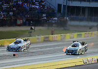 Sept. 21, 2012; Ennis, TX, USA: NHRA funny car driver Todd Lesenko (right) races alongside Mike Neff during qualifying for the Fall Nationals at the Texas Motorplex. Mandatory Credit: Mark J. Rebilas-