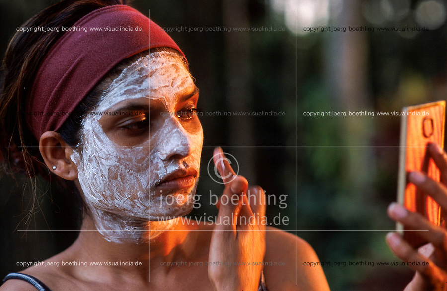 INDIA, Mangalore, woman bleach face and face hair skin with bleaching agent